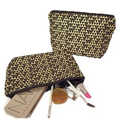 "Machine washable makeup bag in a vibrant black and metallic gold Aztec print. Bag measures 10""x8"" with a black zipper."
