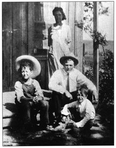 Woody Guthrie, momma Nora, daddy Charley and little brother George on their porch..Okemah, Oklahoma.