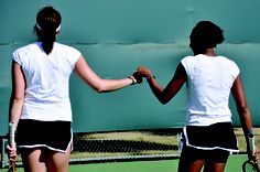 """Tennis doubles senior pictures- this will be me and Keanna! Ha. We always tell Mrs.Myers that we're the true """"mixed"""" doubles team. :)"""
