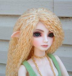 Yard Doll Wig (1 of 2) Crochet around doll head, separate yarn and rug weave through crochet.
