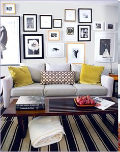 Something about this really appeals to me. We definitely need art behind our sofa, and I like the idea of yellow cushions on our grey sofa.