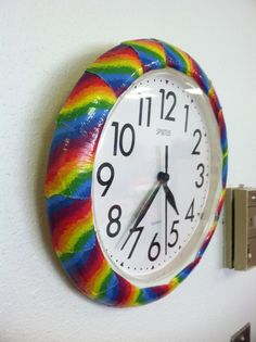 Wall clock decorated with rainbow duct tape.