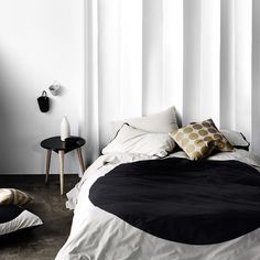 AURA Home, Winter 2014, Big Spot quilt cover in black.