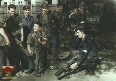 """Group of soldiers from Battalion """"Czata in Wola district, inspect English Anti-tank weapons """"PIAT"""". Andrzej Maringe """"Andrzej"""" is standing third from the left and Stanisław Potworowski """"Potwór"""" is sitting in the middle, Warsaw Uprising, August Invasion Of Poland, Poland Ww2, Warsaw Uprising, South African Air Force, Global Conflict, History Online, Armed Forces, World War Two, Weapons"""