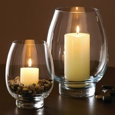 Hurricane candles - I like the pebbles - they add an earthy element to the room