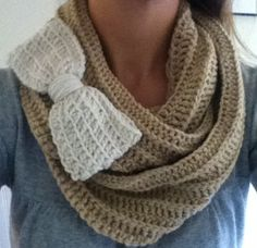 Crochet infinity scarf with bow by Bowteaque on Etsy, $30.00... For anyone looking for a last minute christmas gift for me! :)