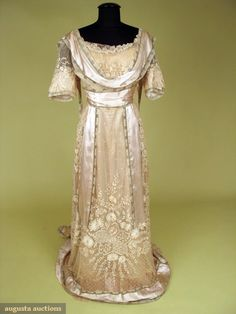 """PARIS SILVER BROCADE & LACE TEA GOWN, c. 1912    Shell pink silk charmeuse w/ delicate silver metallic brocade border & large panels of tambour embroidered net, label, """"Agnes 23, Rue Louis-le-Grand, Paris"""", boned w/ silk lining, (stain on lace) otherwise excellent."""