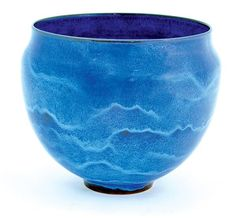 Gertrud & Otto Natzler earthenware footed bowl, executed in a blue crystalline glaze, bottom marked ''Natzler'' and showing the original inventory number M446, 8.5''h x 10''w Provenance: Purchased directly from the artists, thence by family descent