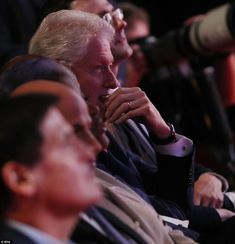 President Bill Clinton looked nervous as he listened to his wife Hillary Clinton debate Republican Donald Trump