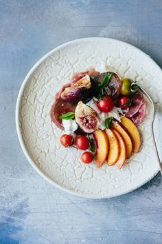 Tomato, fig, peach, prosciutto, and burrata salad