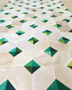 Slow progress, but I've made it to halfway. #kimishavingagrandson #carsonsgreenquilt #sewing #quilting #babyquilt #solidsquilt