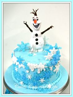 Frozen cake with edible handmade olaf