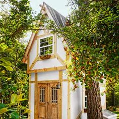 The winner of our Best Yard Redo modeled this magical playhouse after timber-frame buildings he'd admired abroad. | Photo: Adam Ewing | See more winners @thisoldhouse.com
