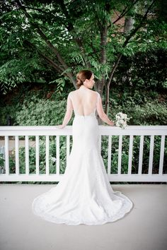 Bride standing on her front porch with her back to the camera at this wedding at The Venue Chattanooga by Chattanooga Wedding Photographer, Amanda May Photos.