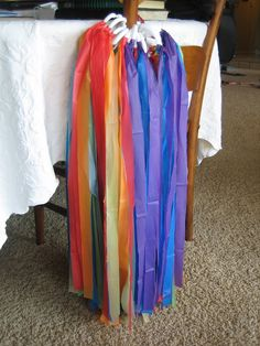 Rainbow streamers...using plastic tablecloths from $ Store + shower curtain ring