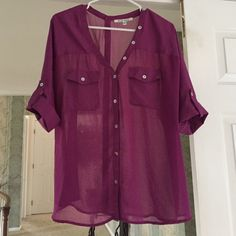 Pink button up sheer blouse Loose fitting pink sheer blouse. Buttons up front and up back! There is 1 button on front, second from the bottom that is cracked. Other than that this is in great shape! Purchased at BP section of Nordstroms Black Rain Tops Blouses