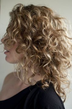 Side View of Shoulder Length Soft Curly Hairstyle for One Shoulder Dress