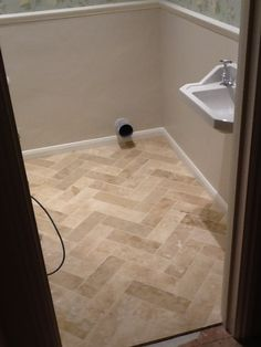 Travertine herringbone with a smaller size like 4x12...pretty
