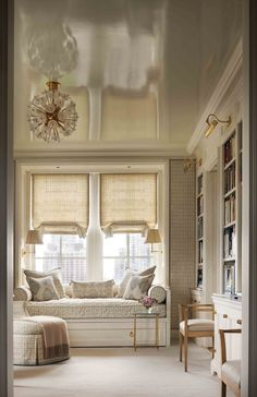 Library window seat with flanking sconces