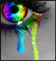 Rainbow eye contacts with tears makeup.