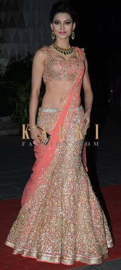 Gauhar Khan in a sequined lehenga and blouse. Bollywood fashion. Indian fashion.