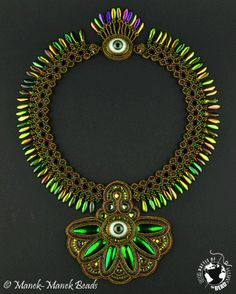 The Eye Of The Beholder by Manek-Manek Beads  ~ created for The Battle of the Beadsmith 2012 ~ Intriguing & achingly beautiful. I do so love this piece!