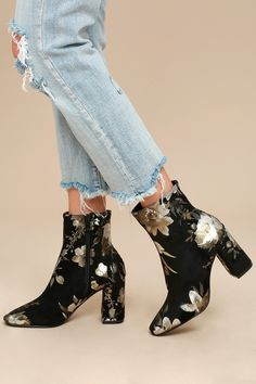 "Look forward to the amazing outfits that await you in the My Generation Black Floral High Heel Mid-Calf Boots! A squared-off toe meets a fitted 7"" shaft (made from vegan suede with metallic silver and olive green floral appliques) with a handy zipper at the instep."