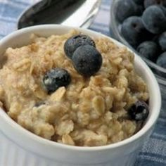 Oatmeal is cooked with berries, applesauce, and wheat germ. It's delicious!