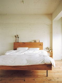 Perfect bed. Wood and all white, simple heaven