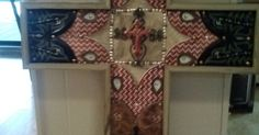 I made these crosses for Christmas presents. My husband cut a cross out of 1/2 inch plywood and we cut the tops off of old boots with a razor blade.  I washed t…