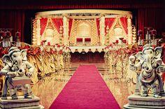 gold mandap w/ red draping