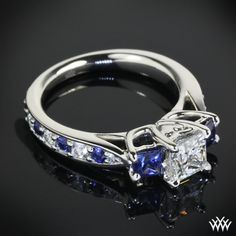 blue: This beautiful Custom 3 Stone Diamond Engagement Ring is set in platinum and features a A CUT ABOVE® Princess Cut center diamond. The side stones and shank hold in blue sapphires and A CUT ABOVE® Hearts and Arrows Diamond Melee. Princess Cut Rings, Princess Cut Engagement Rings, Three Stone Engagement Rings, Diamond Engagement Rings, Bling Bling, Ruby Wedding Rings, Sapphire Wedding, Bridal Rings, Gold Wedding