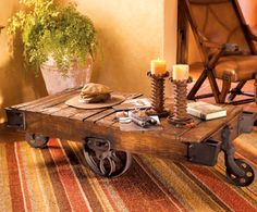 Vintage Cotton Bale Cart used as a Table.  These carts were once used in U.S. furniture factories for transporting heavy bolts of fabric, parts and tools around the work floor.
