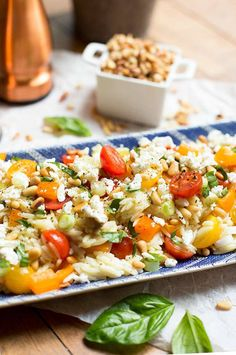 Lemon-Orzo Pasta Salad - Toss some orzo with fresh tomatoes and peppers, and add a little feta and some pine nuts for the perfect picnic…