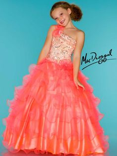 WOW dress! Bright neon coral color is amazing on this cutie.  One shoulder dress has matching sequin on bodice.  Shoulder has tulle floral detail.