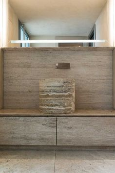 The bespoke bathroom is composed of a stone bathroom vanity unit and a special piece of furniture with integrated seating and mirror for the changing room. Travertine Bathroom, Stone Bathroom, Wc Design, Vanity Design, Stone Cladding, Wall Cladding, Bathroom Vanity Units, Bathroom Goals, Bathroom Design Luxury