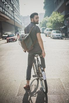 Man with Handlebar mustache and beard on a bicycle for Sergeant Pepper Clothing: http://sgtpepperbrand.com/