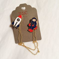 Rocket & spaceman chained lapel badge / pin - collar pins