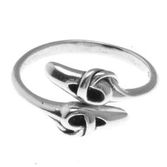 This cute ballet ring is made of genuine .925 sterling silver and is perfect for any dancer or ballerina.  It is adjustable sized, and will fit sizes 6-11.  Shiny silver in color.  Makes a great for a
