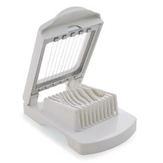 The Egg Slicer!! LOVE IT!!!  Use all the time, Bananas, strawberries, mushrooms, eggs, kiwis...How could you not!!  No more slicing fruits for snack time!