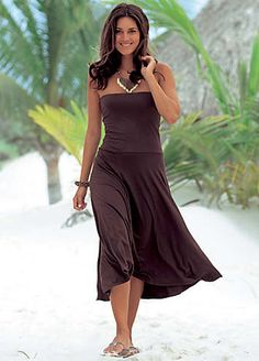 Stylish brown beach dress that can be worn in three different styles. Transform it into a mini dress for dreamy walks along forgotten coastlines, a flowing skirt for sightseeing or a long dress to watch the sun go down. Note, the top section has a double layer for a perfect fit.LASCANA Dress Features:  Colour: Brown  Washable  95% Viscose, 5% Elastane