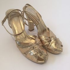 Kate Spade gold shoes Gold snake look leather. Straps go around ankle. Few marks on heels but nothing noticeable enough. Size 7.5 kate spade Shoes Heels