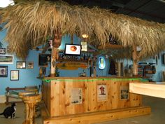 """Colmar, Pa. My Showroom Tiki Bar. 10x10 Custom Red Cedar Tiki Bar, 12x12 thatched roof, footrest, solid pine upper & lower bar tops, cabinets, 36"""" flat screen tv, stereo system, drink rail, liquor shelf, bar sink, ice bin, fridge, beer meister with duel taps, rope lighting, ceiling fan with light kit, glass rack, 15 bar stools. Full photo album can be seen on facebook - https://www.facebook.com/tikikev/photos_albums . For more info: www.tikikev.com or call 800-792-8454, email…"""