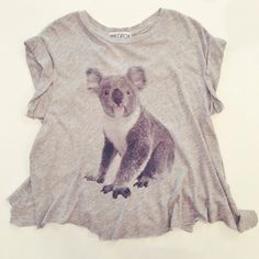 What an adorable koala!!!  Crewneck, rolled sleeves and a roomy body finished by an uneven, jagged hem for that look of your favorite vintage tee! #wildfox #koala #wildfoxtee #kkbloomstyle
