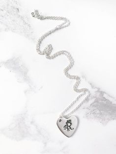 Argentium silver heart necklace with the initial of your choice. Hand stamped decorative monogram necklace from A to Z - all. Handmade Silver Jewellery, Silver Jewelry Box, Silver Chain Necklace, Silver Hoop Earrings, Sterling Silver Necklaces, Garnet Necklace, Silver Ring, Sterling Jewelers, Jewelry Logo