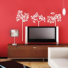 Loving the wall graphics behind the tv.  Exactly the touch we need!