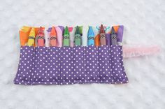° 100% Cotton  ° Holds 8 crayons  ° Size: 8.5 x 5.5 inches