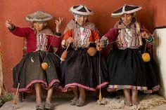 Nicolasa Suyo, Nicolasa Condori, and Hilaria Corpora spin together at the CTTC weaving center. In Cusco, Peru.