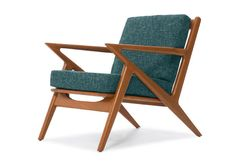 The Kennedy Chair in Bishop Ivory fabric, with Walnut wood stain, by Thrive Furniture $899
