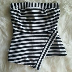 BOUTIQUE strapless top Black and white striped strapless top. Nice and heavy almost structured fabric. Asymmetric line down left side.  Length of back 14 inches and length of front at longest part of Asymmetric hem is 18 3/4 inches. 95% polyester 5% spandex. NWT boutique Tops